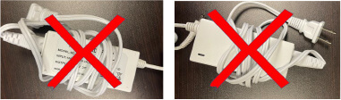 image of power supply with cords wrapped around power bank in middle causing stress on cord which could result in damage