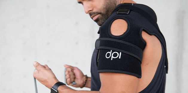 man wearing dpl joint wrap on shoulder while working out